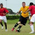 a defender jockeys an opposing player