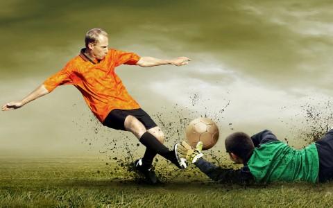 a striker tries to beat a goalkeeper