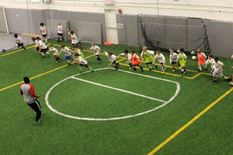 children train for indoor soccer