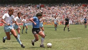 Maradona dribbles round the whole England team