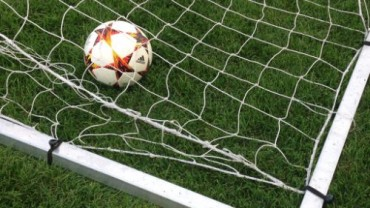 a ball in the back of a net