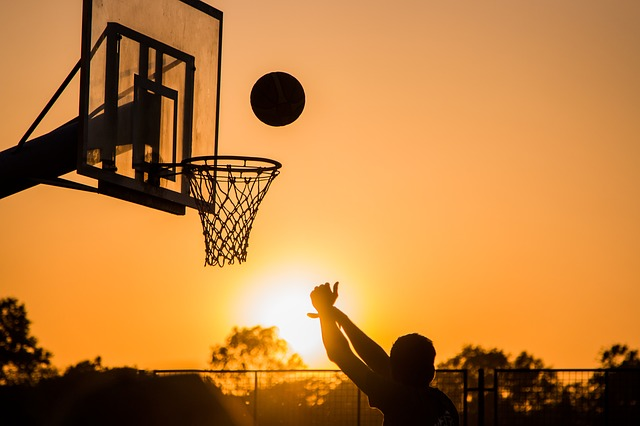 a basketball hoop in the sunset