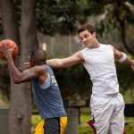 two players play basketball