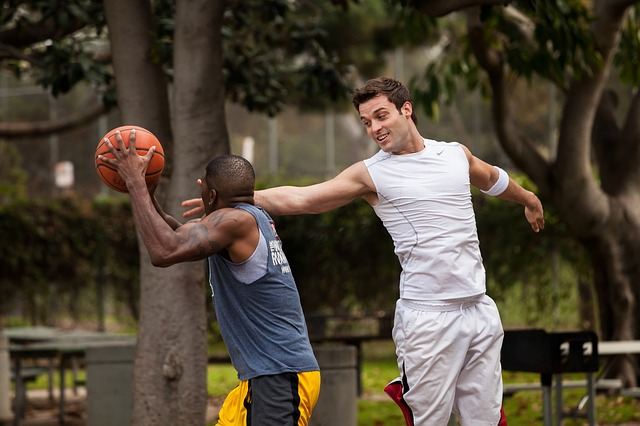 two players play basketball